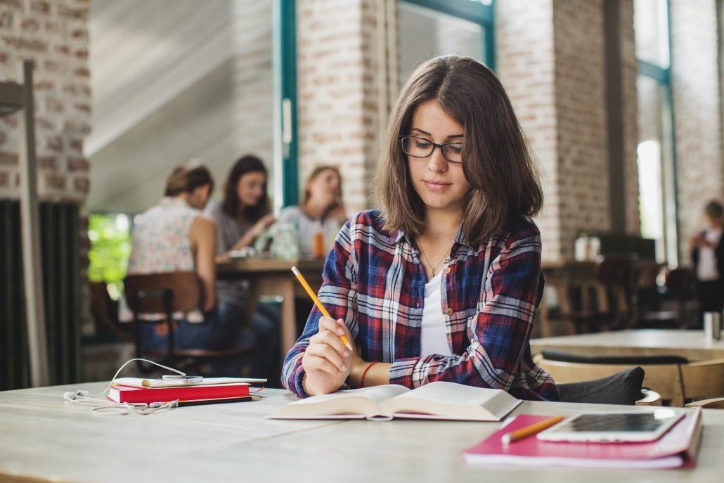 College student with glasses studying